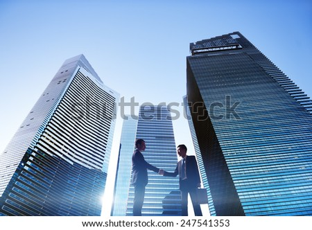 Businessmen Cityscape Handshake Partnership Concept - stock photo