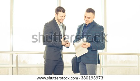 businessmen discussion with notes - stock photo