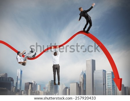 Businessmen falling down toward the economic crisis - stock photo