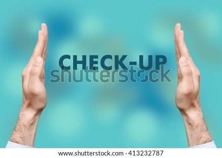 """Businessmen from both hands """" CHECK-UP """" writes - stock photo"""