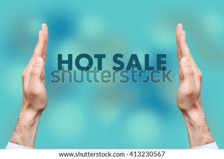 "Businessmen from both hands "" HOT SALE "" writes - stock photo"