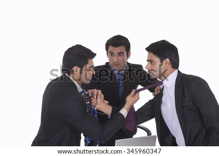 Businessmen getting into a fight - stock photo