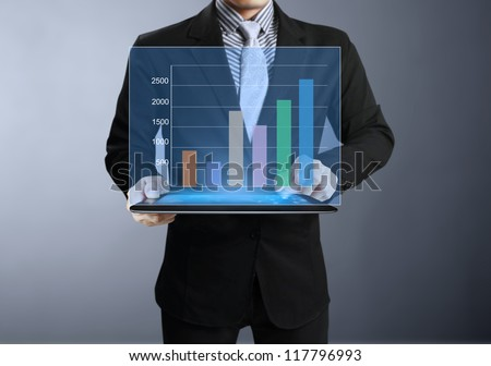 Businessmen graph on tablet and show tablet - stock photo