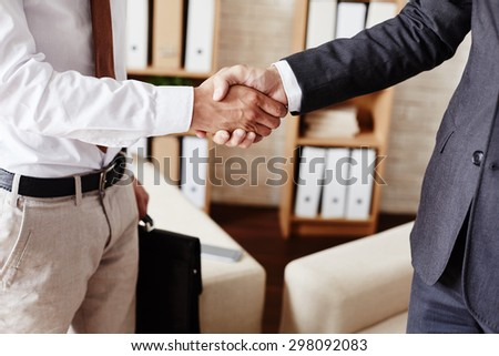 Businessmen handshaking after signing contract - stock photo