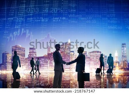 Businessmen Having a Handshake Outdoors - stock photo