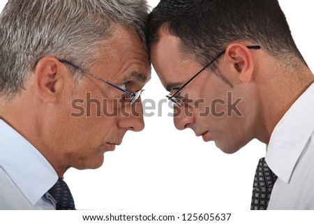 Businessmen head to head - stock photo