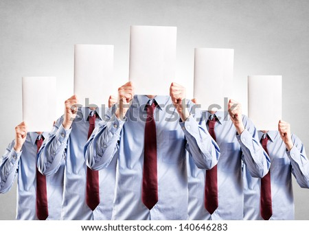 Businessmen holdings blank space over their heads - stock photo