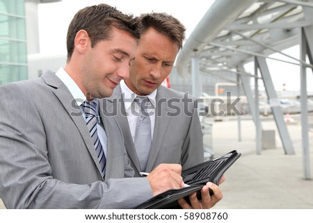 Businessmen in a business meeting away from the office - stock photo