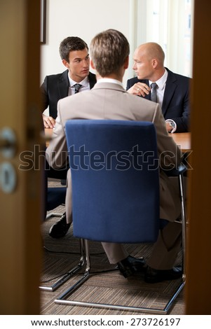 Businessmen in meeting at board room - stock photo