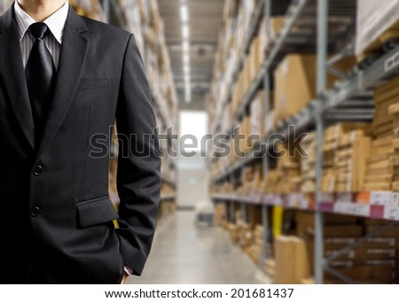 Businessmen In Warehouse preparing goodsfor dispatch - stock photo