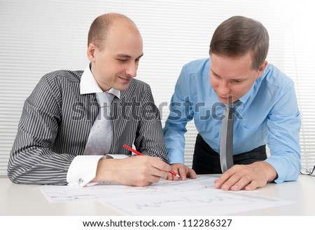 Businessmen meeting in office - stock photo