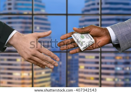 Businessmen passing american dollars. Financial deal in the evening. Criminal buys the power. We're together in this. - stock photo