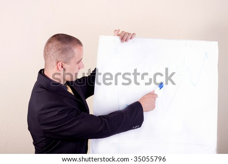Businessmen point at the demonstration table - stock photo
