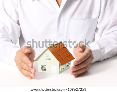 businessmen Protect Your House - stock photo