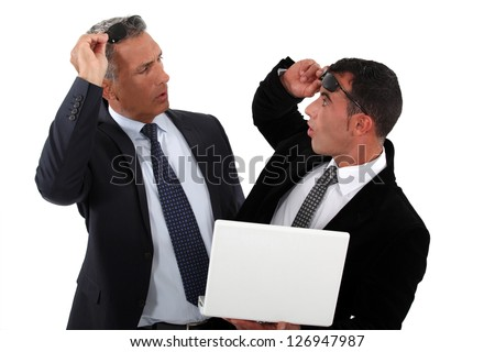 Businessmen recognizing one another - stock photo