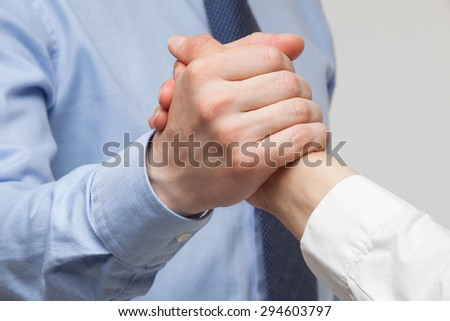 Businessmen's hands demonstrating a gesture of a strife or solidarity, white background - stock photo