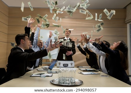 Businessmen scatter the dollars. Managers celebrate success. Successful business. - stock photo