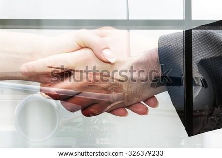 Businessmen shake hands in front of jet, unusual double exposure - stock photo