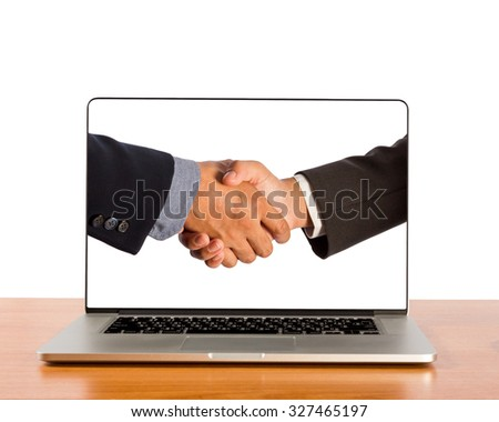 Businessmen shake hands in laptop screen. - stock photo