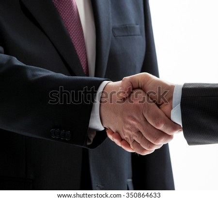 Businessmen shake hands isolated on white - stock photo