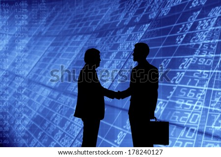 Businessmen shaking hands. - stock photo
