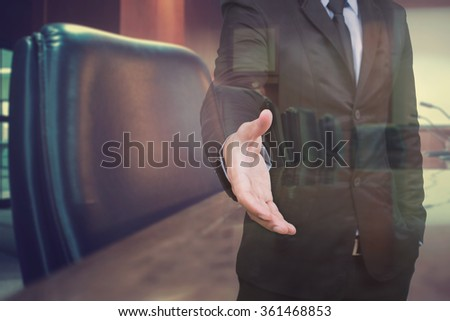 businessmen shaking hands and blur conference room background in double exposure,business concept  - stock photo