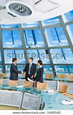 Businessmen shaking hands in the conference room - stock photo