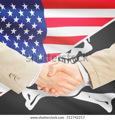 Businessmen shaking hands - United States and Jolly Roger - stock photo