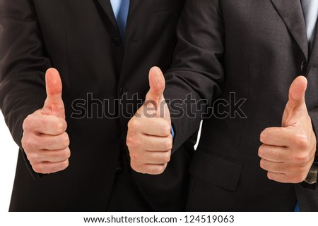 Businessmen showing their thumbs up - stock photo