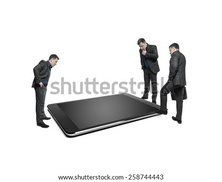 Businessmen take counsel, looking at huge display of tablet computer. On a white background. Conceptual image. - stock photo