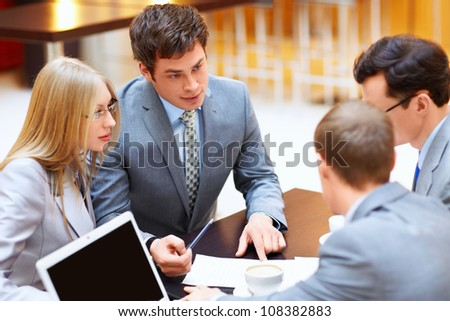 Businessmen with laptop in a meeting - stock photo