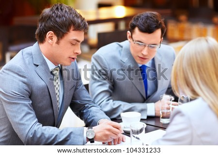 Businessmen with laptop in office - stock photo