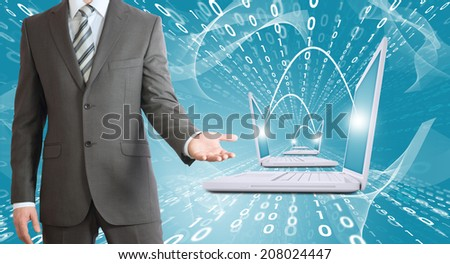 Businessmen with laptops. Figures as backdrop - stock photo