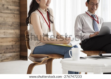 Businessmen with notebook  discussing graphs on meeting. - stock photo