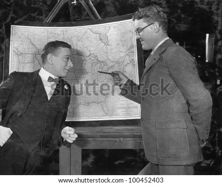 Businessmen with US map - stock photo
