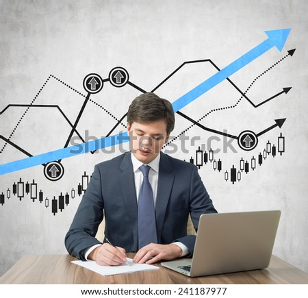 Businessmen working in office with drawing graph on wall - stock photo