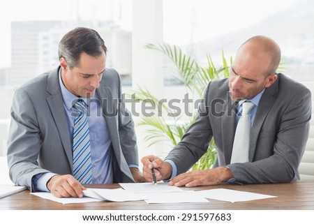 Businessmen working together in an office - stock photo