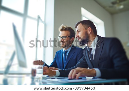Businessmen working with computer in team - stock photo