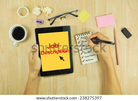 Businessmen write job description on the desk. - stock photo