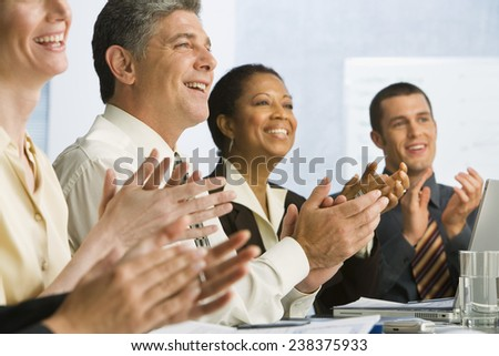 Businesspeople Applauding Speech - stock photo