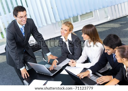 Businesspeople at business meeting, seminar or conference - stock photo