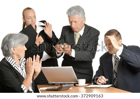 Businesspeople at work with laptop - stock photo