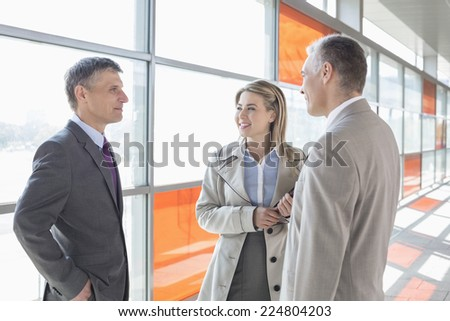 Businesspeople communicating on train platform - stock photo