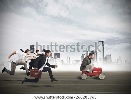 Businesspeople competing in a race for career - stock photo