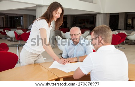 Businesspeople  discussing a joint project during teamwork at the conference hall - stock photo