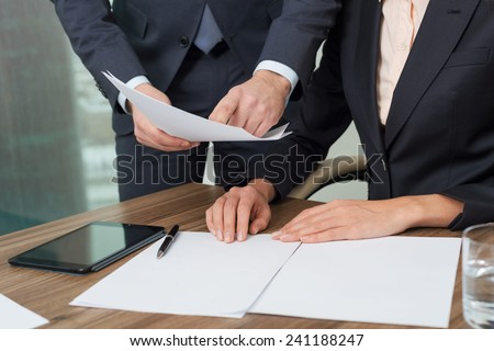 Businesspeople discussing business plan in office - stock photo