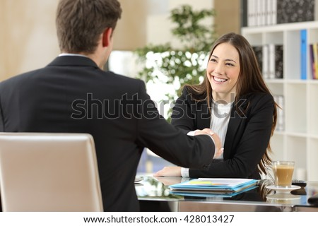 Businesspeople handshaking after negotiation or interview at office - stock photo