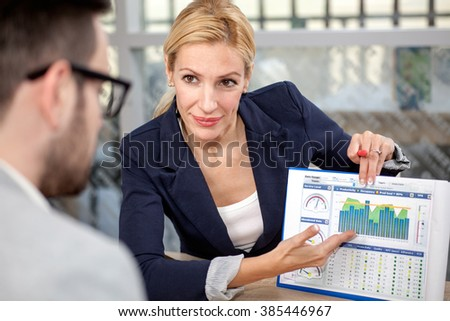 businesspeople having a business meeting at coffee shop - stock photo