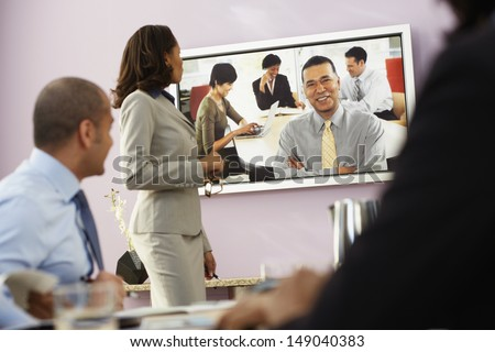 Businesspeople having video conference - stock photo