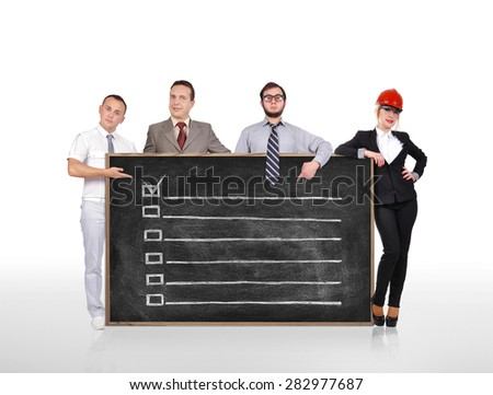 businesspeople holding chalk board with drawing application form - stock photo